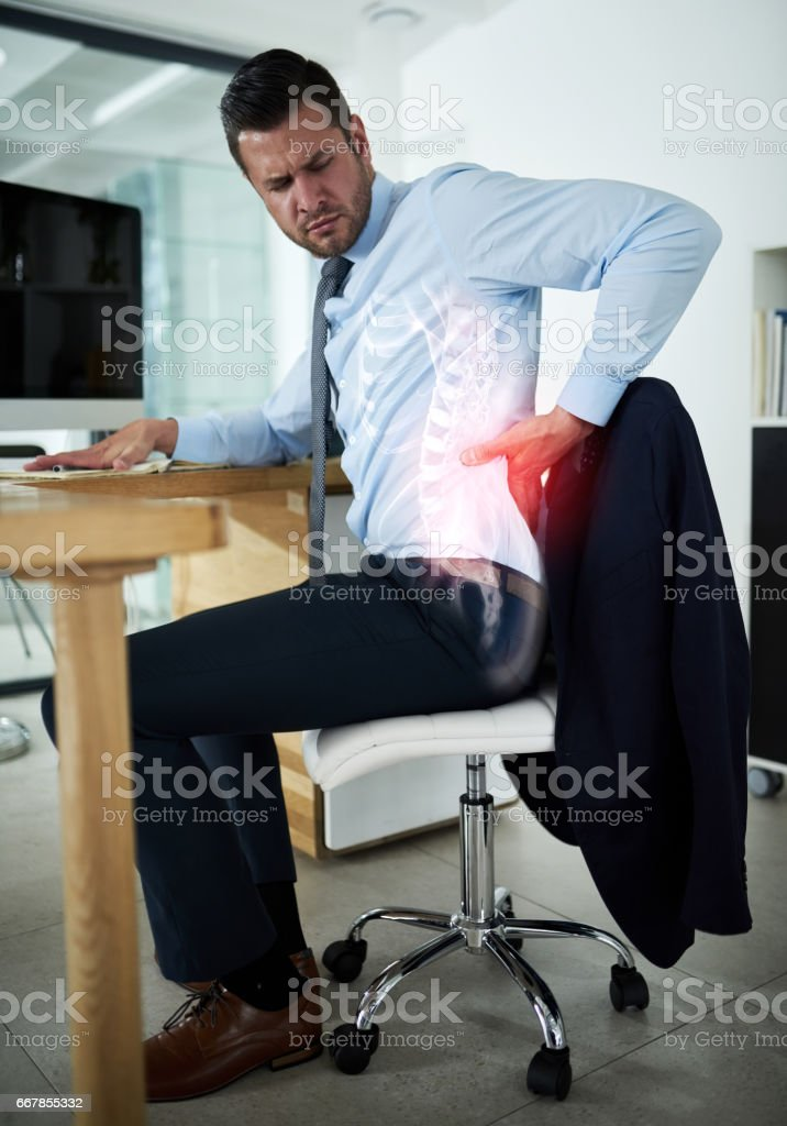 Work demands are taking a toll on his health stock photo