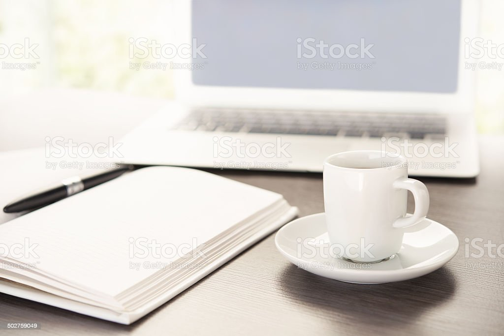 work desk with  cup of coffee computer laptop, notebook, pen stock photo