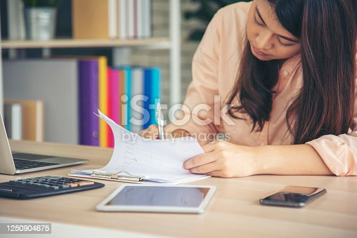 836871418 istock photo Work from home conceptual woman working on laptop at home cause of coronavirus covid-19 world epidemic virus infection. Asian woman connect internet working at home office wireless internet technology 1250904675