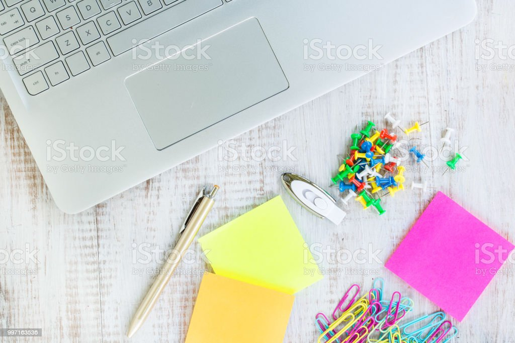 Work From Home Desk With Computer Laptop and Office Supplies stock photo