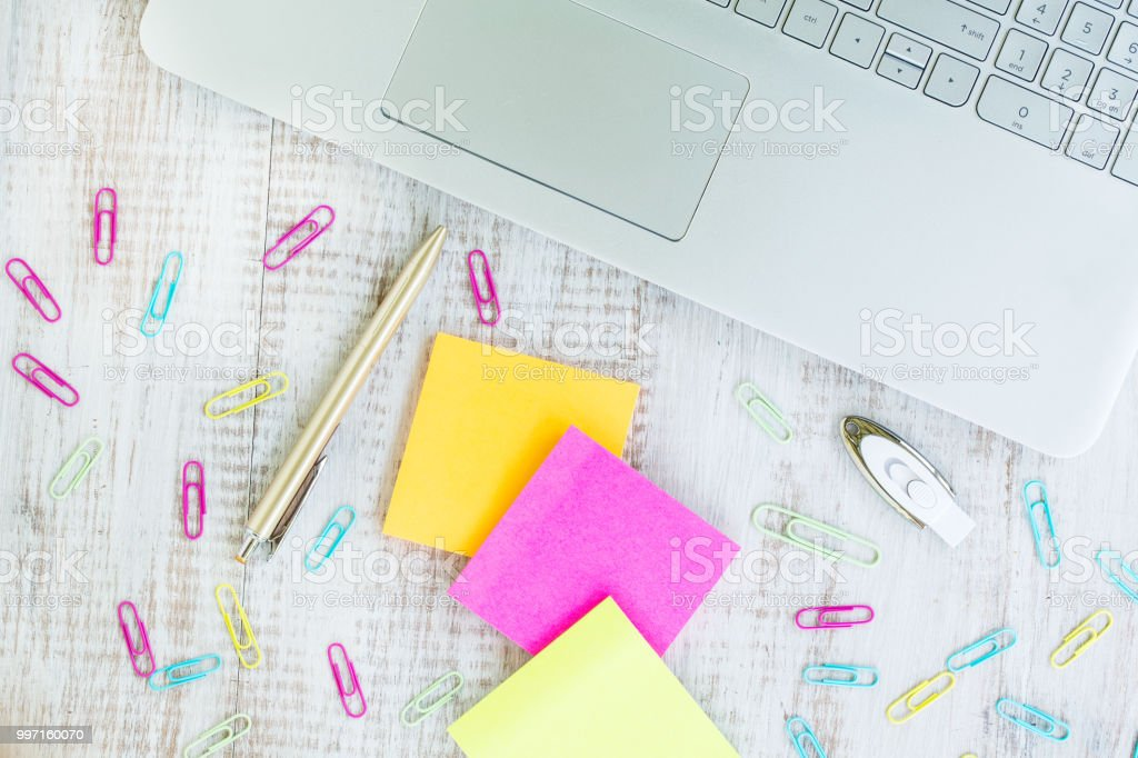 Work From Home Desk With Laptop Computer and Post It Notes stock photo