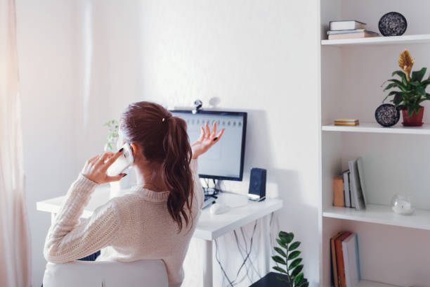 Work from home during coromavirus pandemic. Woman stays home. Workspace of freelancer. Office interior with computer