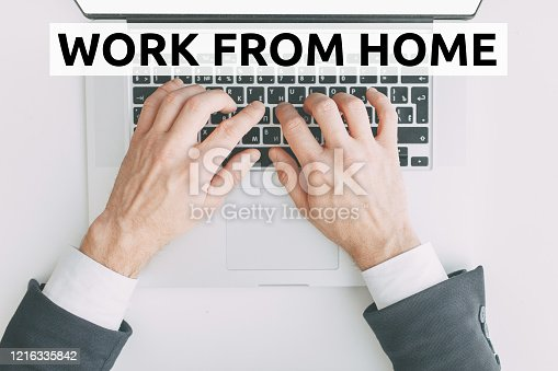 Work from home during quarantine. Hands at work on a laptop with bokeh. Online education on the Internet.