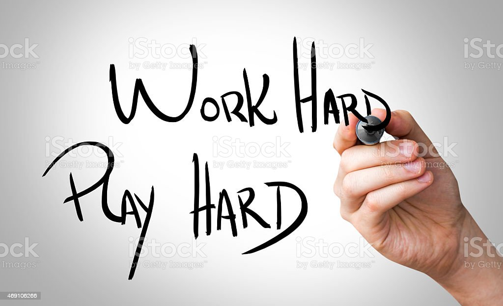 Work Hard, Play Hard written on the Wipe board stock photo