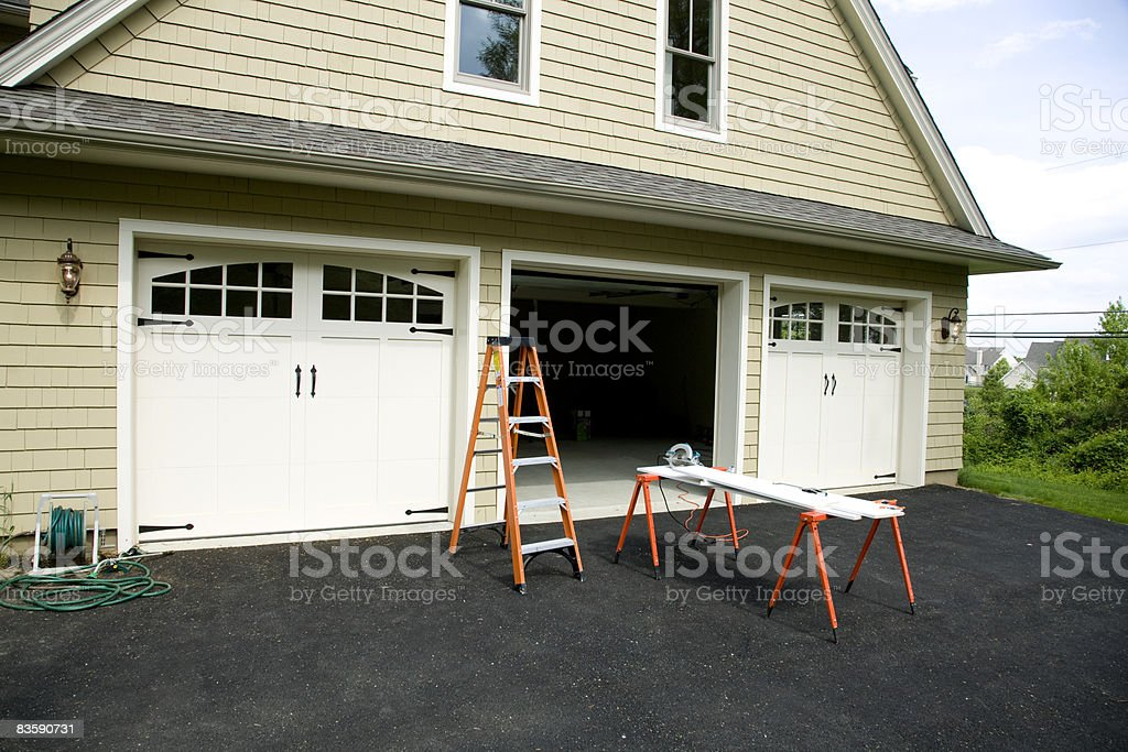Work horse set up in suburban driveway royalty-free stock photo