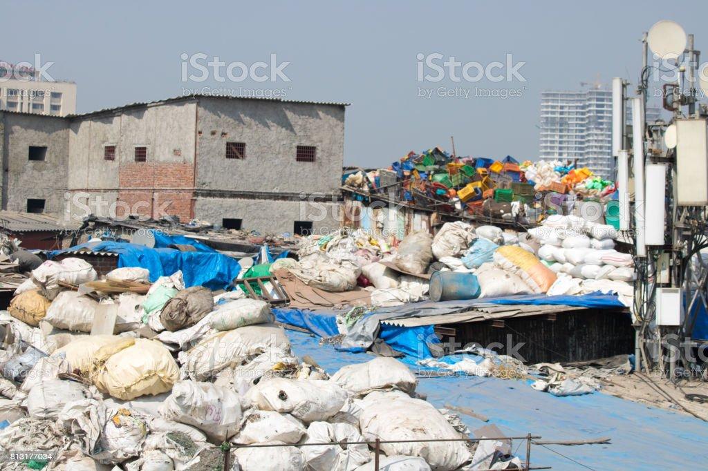 Work in the sloppy neighborhood india mumbai recycle plastic and washing clothes stock photo