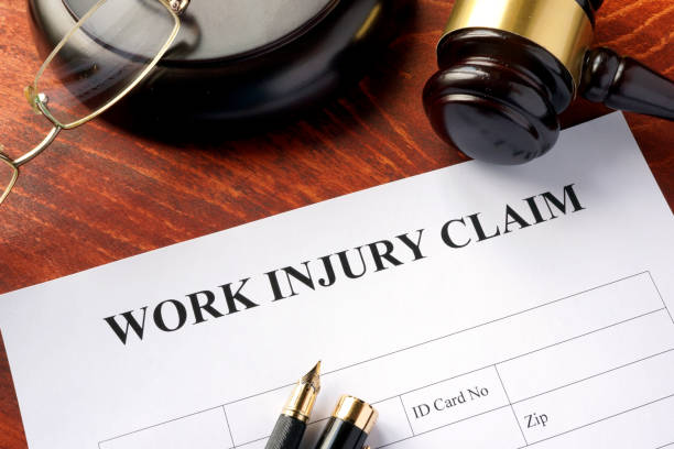 Work injury claim form on a table. stock photo
