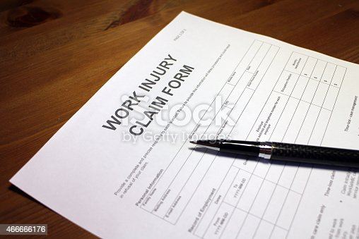 Someone filling out work injury claim form