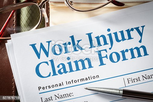 istock Work Injury Claim Form 527878715