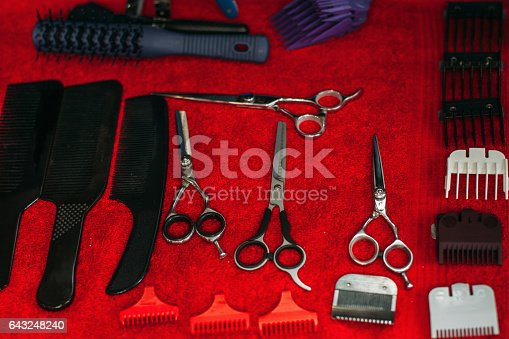 696318954 istock photo Work instruments of hairstylist on table 643248240