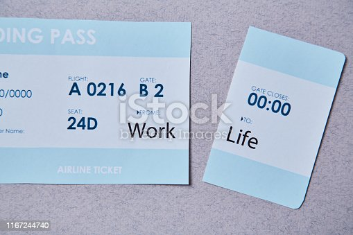1175869940istockphoto Work life balance choice concept. Boarding pass cut into two parts with inscriptions 1167244740