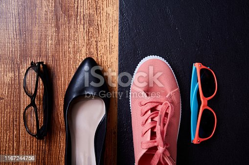 1175869940istockphoto Work life balance choice concept: colored sneakers or sports shoes and strict office shoes 1167244756