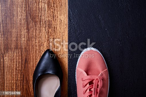 1175869940istockphoto Work life balance choice concept: colored sneakers or sports shoes and strict office shoes 1167244769