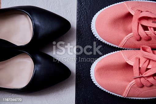 1175869940istockphoto Work life balance choice concept: colored sneakers or sports shoes and strict office shoes 1167244770