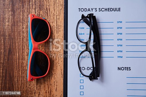 1175869940istockphoto Work life balance choice concept: colored sunglasses and strict office glasses 1167244746