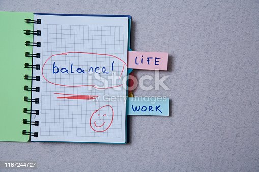 1175869940istockphoto Work life balance choice concept. Stickers with inscriptions in a notebook. 1167244727