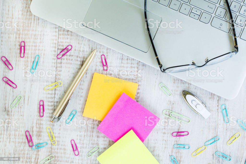Work Office Desk With Laptop and Paper and Pen From Above stock photo