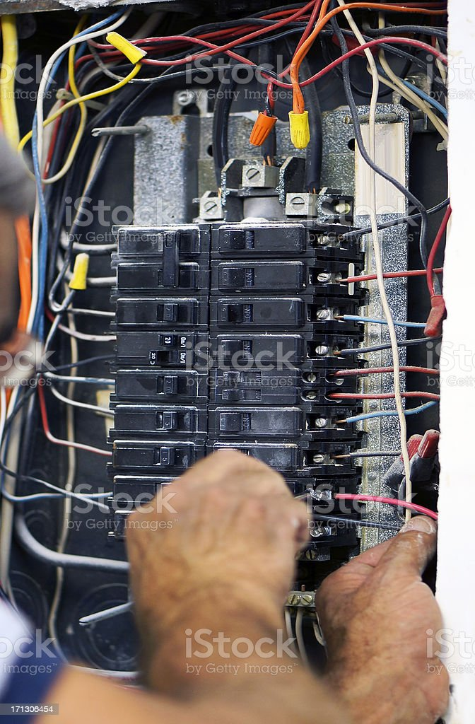 Work on electrical panel stock photo