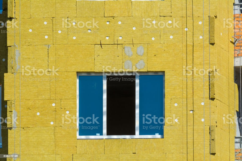 work on the external walls of glass wool insulation and plaster stock photo