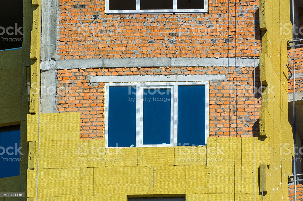 work on the external walls of glass wool insulation stock photo