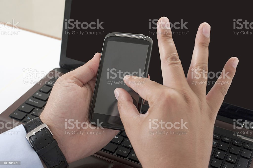 work on two electronic devices stock photo