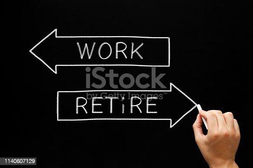 istock Work Or Retire Decision Arrows Concept 1140607129