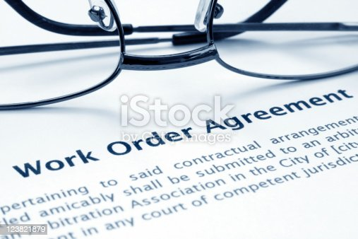 Close up of glasses on work order agreement