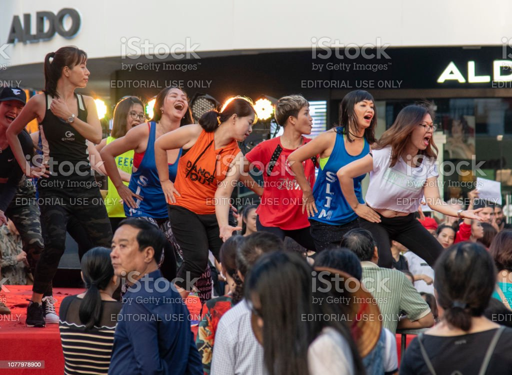 A typical day in downtown Hanoi, Vietnam, where young women are...