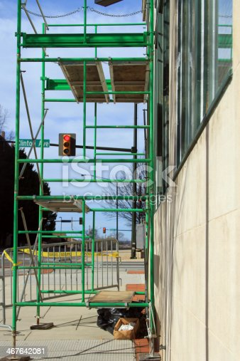 Scaffolding use as work platform to apply a new finish to the outside of a building.
