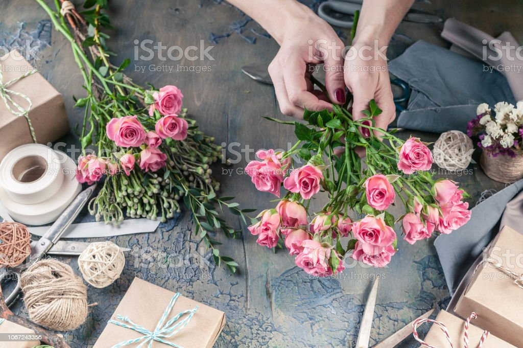 Work process of florist. Female hands making wedding bouquet on a...
