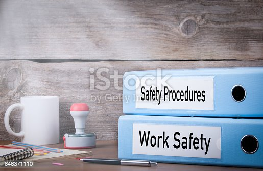 istock Work Safety and Safety Procedures. Two binders on desk in the office. Business background 646371110