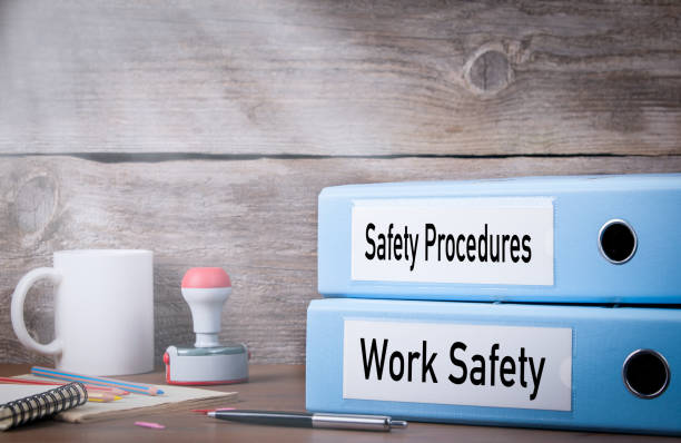 Work Safety and Safety Procedures. Two binders on desk in the office. Business background Work Safety and Safety Procedures. Two binders on desk in the office. Business background. hazardous chemicals stock pictures, royalty-free photos & images