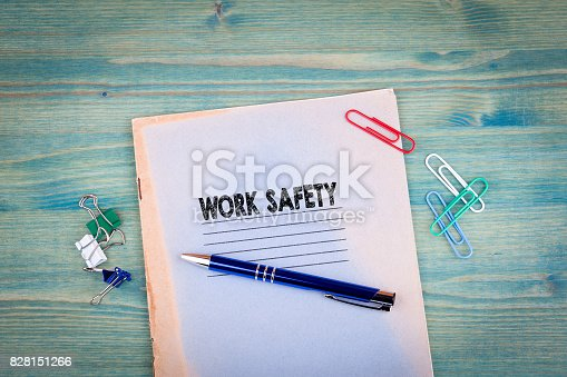 istock work safety concept. Notebook on a bright green background. Office stationery accessories 828151266