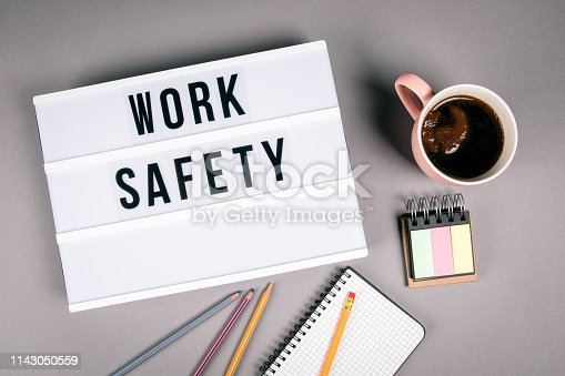 Work safety. Text in light box. Pink coffee mug on gray background