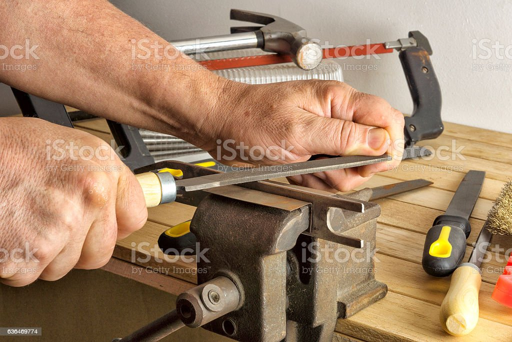 Work saws a file item hamstrung stock photo