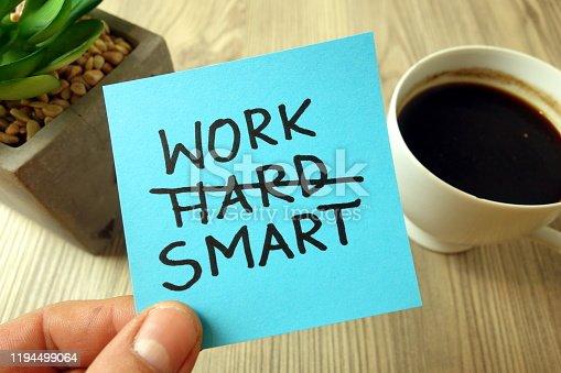 Work smart text - motivational reminder handwritten on sticky note