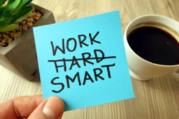 Work smart - motivational reminder handwritten on sticky note stock photo