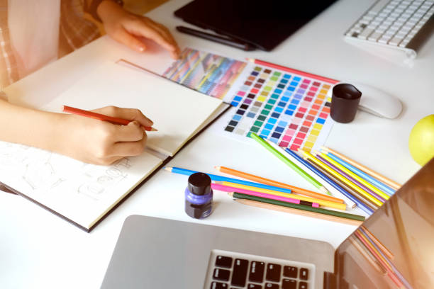 work space and designer working concept. Young designer drawing sketches on graphic tablet in studio office. illustrator stock pictures, royalty-free photos & images