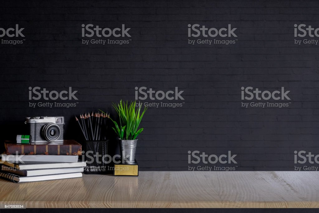 Work space Mock up : white marble tabletop with notebooks, vintage camera and houseplant. white marble desk with copy space for products display montage. stock photo