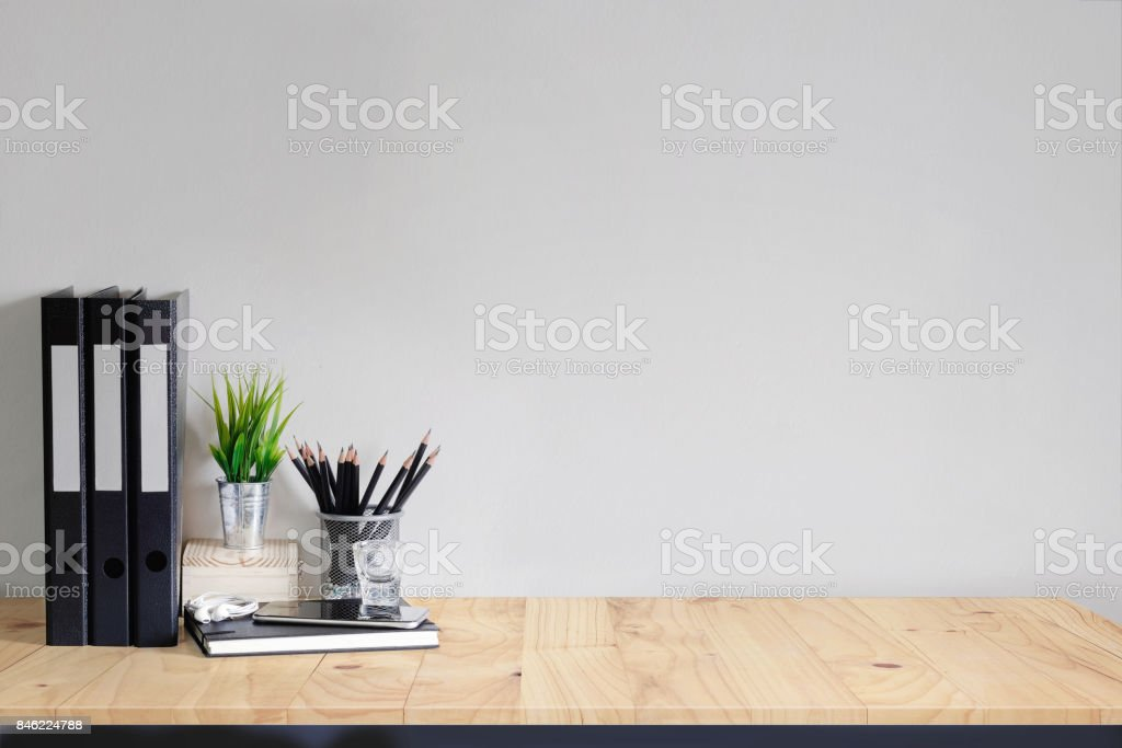 Work space Mock up white tabletop with files, pencils and houseplant. wood desk with copy space for products display montage. stock photo
