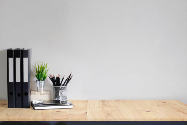 work space mock up white tabletop with files, pencils and houseplant. wood desk with copy space for products display montage. - desk stock photos and pictures