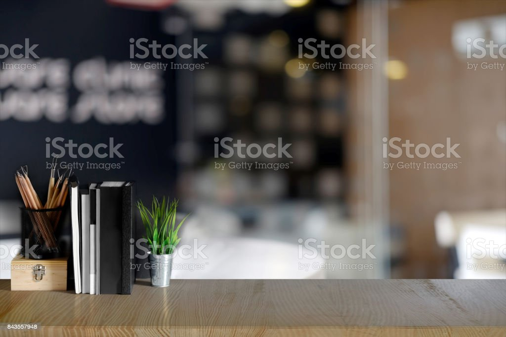 Work space Mock up : Wood modern work space desk table with supplies in office. stock photo