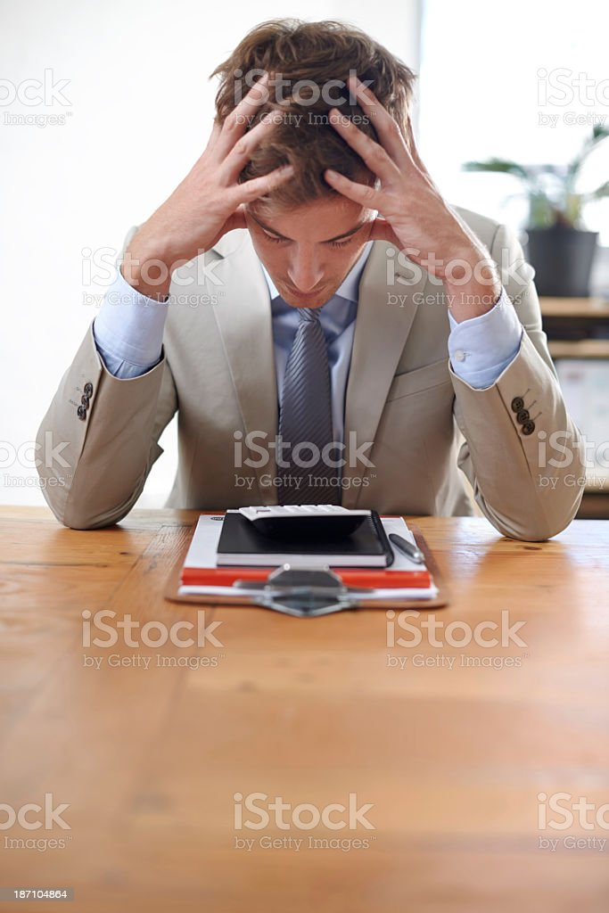 Work stress is getting to him royalty-free stock photo