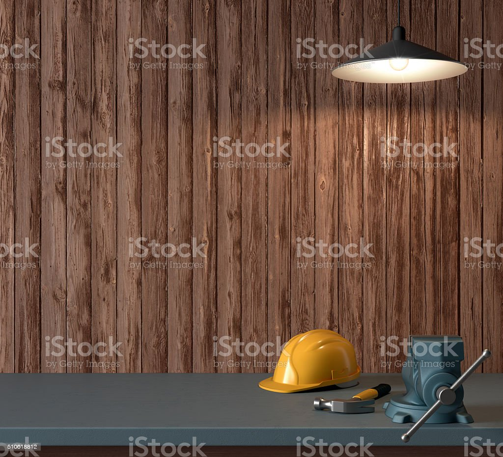 work table of a carpenter, helmet and hammer stock photo