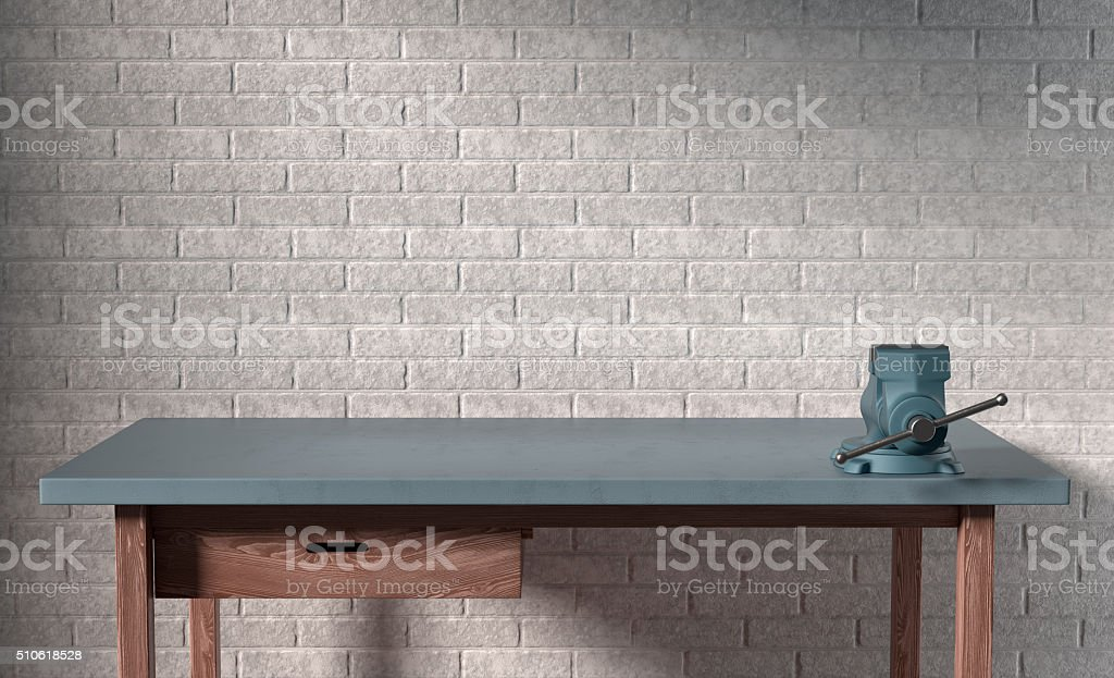 work table of a carpenter on white brick wall background stock photo