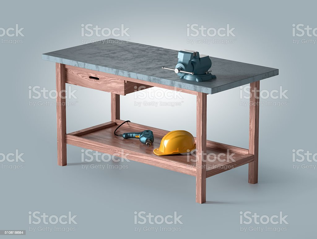 work table of a carpenter with vise, helmet and drill stock photo