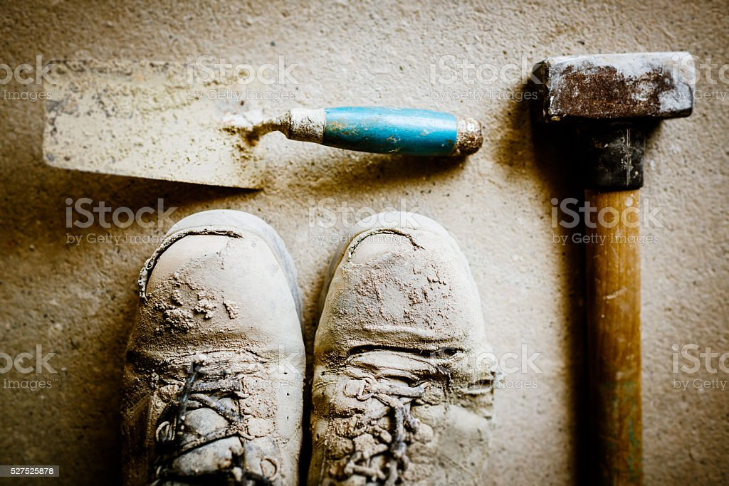 Work tools and obsolete boots of builder stock photo