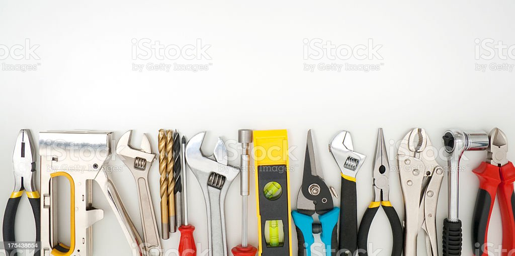 Work tools lined up on a white background stock photo