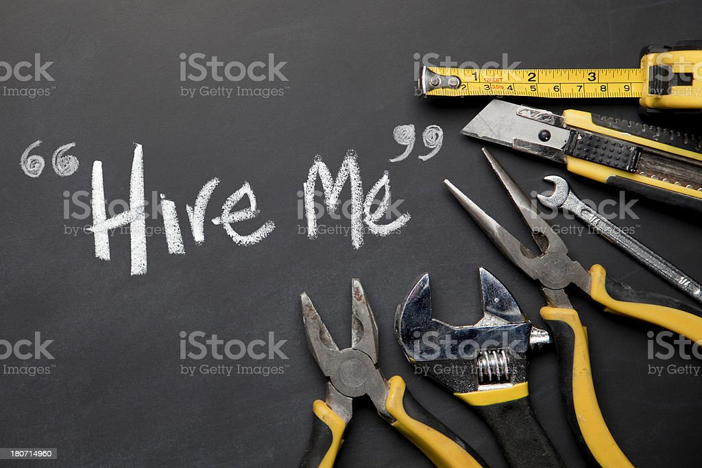 Work Tools On Blackboard With 'Hire Me' Written In Chalk stock photo