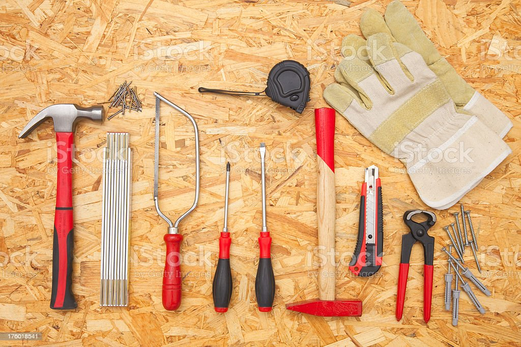 Work tools on chipboard royalty-free stock photo